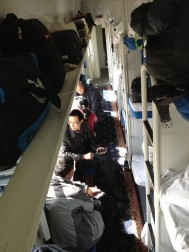 Chinese trains. This is the hard sleeper section, the bunks are 3 high, in banks of six. There are soft sleepers, which is basically first class. Like this but cabins. Then there a soft seats, the second most expensive and best for long daytime journeys, reclining seats and the like. Next is hard sleepers which is these, then bottom of the price scale are hard seats.